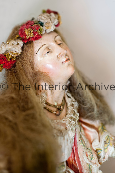Detail of an 18th century Napolitan statue of a girl in traditional costume