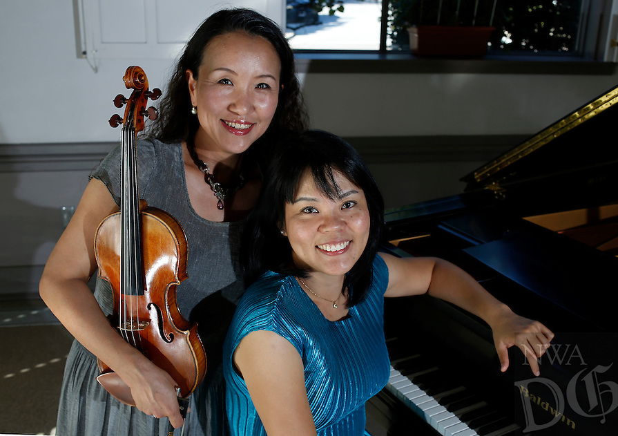 NWA Media/DAVID GOTTSCHALK - 9/22/14 - Miho Oda-Sakon, left, and Tomoko Kashiwagi at St. Paul's Episcopal Church in Fayetteville Monday September 22, 2014 will play a benefit concert for the victims the Maumelle/Little Rock area tornado that occurred this past spring and the 2011 tsunami in Japan.