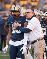 Pitt wide receiver Tyler Boyd (23) gets encouragement from Pitt head coach Pat Narduzzi. The Pitt Panthers football team defeated the Louisville Cardinals 45-34 on Saturday, November 21, 2015 at Heinz Field, Pittsburgh, Pennsylvania.
