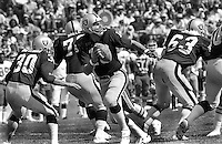 Oakland Raiders QB Jim Plunkett bacl to pass protected by Mark Van Eeghen, Art Shell and Gene Upshaw...(1980 photo by Ron Riesterer)
