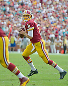 Washington Redskins quarterback Kirk Cousins (8) looks for a receiver as he rolls out in the second quarter against the Miami Dolphins at FedEx Field in Landover, Maryland on September 13, 2015.<br /> Credit: Ron Sachs / CNP