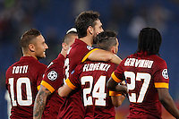 Calcio, Champions League, Gruppo E: Roma vs CSKA Mosca. Roma, stadio Olimpico, 17 settembre 2014.<br /> Roma players celebrate after CSKA Moskva defender Sergei Ignashevic scored an own goal during the Group E Champions League football match between AS Roma and CSKA Moskva at Rome's Olympic stadium, 17 September 2014. AS Roma won 5-1.<br /> UPDATE IMAGES PRESS/Riccardo De Luca