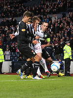 David Barron challenged by Mikael Lustig (left) and Scott Brown in the St Mirren v Celtic Scottish Communities League Cup Semi Final match played at Hampden Park, Glasgow on 27.1.13.