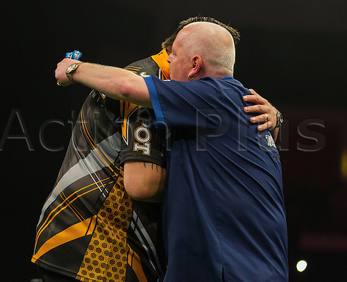 31.03.2016. The Motorpoint Arena, Cardiff.  Betway PDC Premier League Darts Judgement Night. Adrian Lewis and Robert Thornton embrace each other before the match