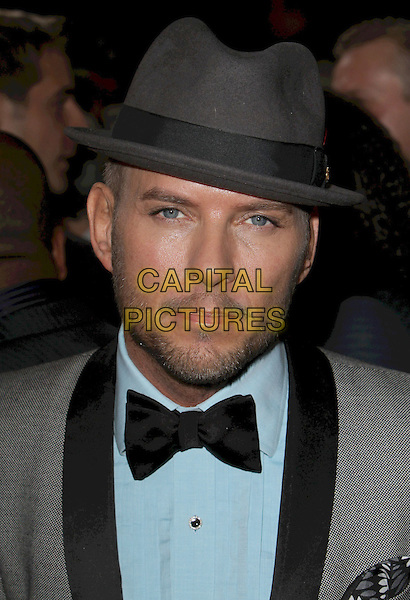"MATT GOSS .""Burlesque"" Los Angeles Premiere held at Grauman's Chinese Theatre,Hollywood, California, USA, .15th November 2010..portrait headshot blue tie shirt grey gray hat beard facial hair .CAP/ADM/CH.©Charles Harris/AdMedia/Capital Pictures"
