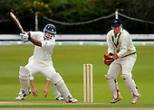 Intercontinental Cup - Scotland V Ireland (four day match) at Mannofield, Aberdeen (day two) - Scotland's Qasim Sheik cuts the ball away past Ireland wicket-keeper Gary Wilson - Picture by Donald MacLeod 18.08.09