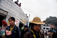 Women shop at a market in Pangzhihua Village, Yuanyang County, Yunnan Province, China.