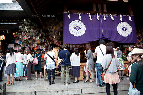 July 7, 2012, Tokyo, Japan - Tokyo Daijingu Shrine visitors write their wishes on colorful papers (Tanzaku) and then hang them on bamboo stalks at Tanabata festival on July 7th. The annual celebration of Tanabata in Japan has been held since the Edo era. It celebrates the meeting of two lovers Orihime and Hikoboshi, according to legend that Milky Way separates these lovers, and may only meet once a year on the seventh day of the seventh month of calendar. (Photo by Rodrigo Reyes Marin/AFLO)