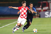 Luka Ivanusec of Croatia and Colin Dagba of France compete for the ball<br /> Serravalle 21-06-2019 Stadio San Marino Stadium <br /> Football UEFA Under 21 Championship Italy 2019<br /> Group Stage - Final Tournament Group C<br /> France - Croatia<br /> Photo Cesare Purini / Insidefoto
