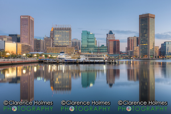 A new day begins in Baltimore with part of the skyline, including the Transamerica Tower and the  World Trade Center, reflected in the still waters of the Inner Harbor during the last hour before sunrise.