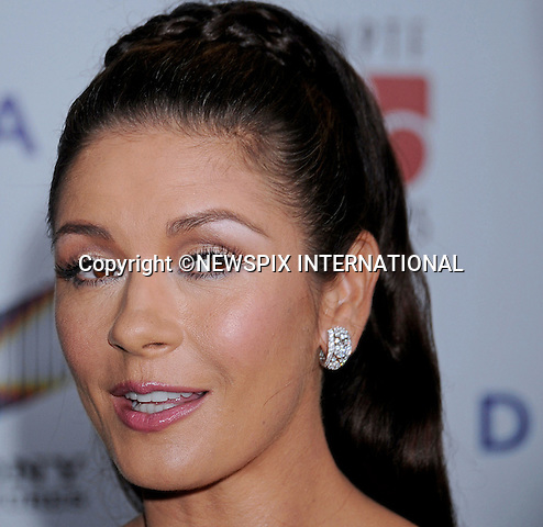 "CATHERINE ZETA JONES.attends the 6th Annual ""A Fine Romance"" to benefit the Motion Picture & Television Fund at Sony Studios, Culver City, Los Angeles_15/10/2011.Mandatory Photo Credit: ©Crosby/Newspix International. .**ALL FEES PAYABLE TO: ""NEWSPIX INTERNATIONAL""**..PHOTO CREDIT MANDATORY!!: NEWSPIX INTERNATIONAL(Failure to credit will incur a surcharge of 100% of reproduction fees).IMMEDIATE CONFIRMATION OF USAGE REQUIRED:.Newspix International, 31 Chinnery Hill, Bishop's Stortford, ENGLAND CM23 3PS.Tel:+441279 324672  ; Fax: +441279656877.Mobile:  0777568 1153.e-mail: info@newspixinternational.co.uk"