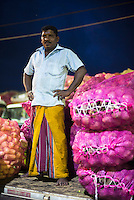 Dambulla wholesale vegetable market, portrait of a truck owner, Dambulla, Central Province, Sri Lanka, Asia. This is a photo of a truck owner at Dambulla wholesale vegetable market, Dambulla, Central Province, Sri Lanka, Asia