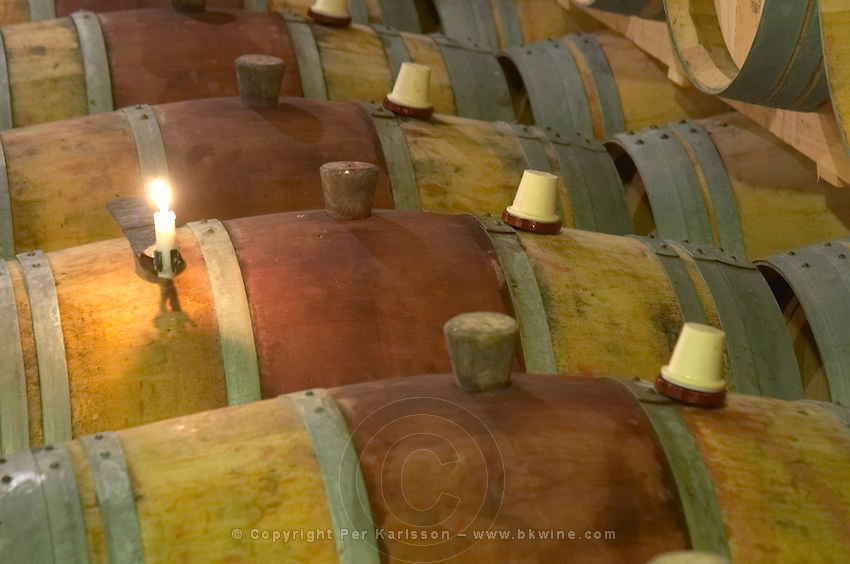 Oak barrel aging and fermentation cellar. Candle for lighting the sulphur pellet inside the barrel. Chateau Brane Cantenac, Margaux, Medoc, bordeaux, France