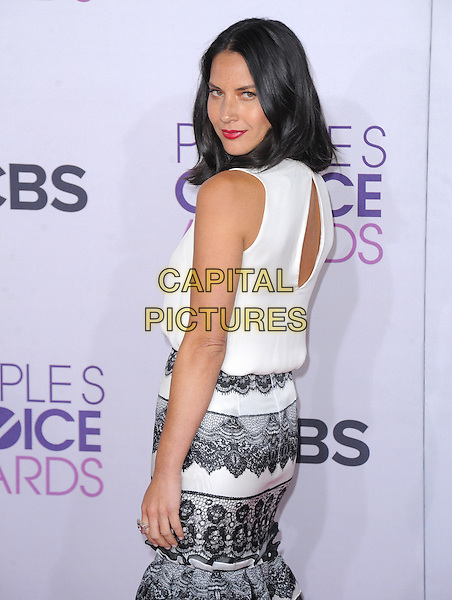Olivia Munn.The 2013 People's Choice Awards held at Nokia Live in Los Angeles, California 9th January 2013                                                                   .half length black lace white skirt top sleeveless looking over shoulder .CAP/DVS.©DVS/Capital Pictures.