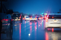 Mopac traffic jam during rain storm with rows of cars waiting to get off the Far West exit, wet, rainy Austin, Texas.
