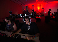 "140927-JRE-7981E-0265<br /> Freshman business management major Sterling Crossman plays ""League of Legends"" in the game room at Senshi-Con Saturday morning at the Egan Center. Photo by James R. Evans"