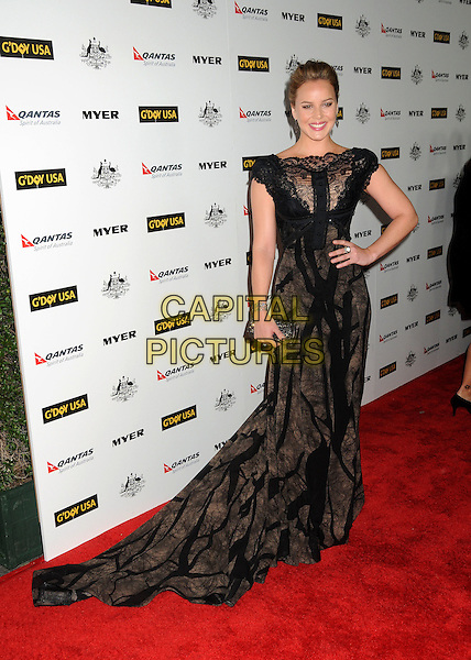 ABBIE CORNISH .2011 G'Day USA Los Angeles Black Tie Gala held at the Hollywood Palladium, Hollywood, California, USA, .22nd January 2011..full length black lace dress long maxi  clutch bag train  hand on hip .CAP/ADM/BP.©Byron Purvis/AdMedia/Capital Pictures.