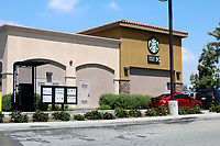 LOS ANGELES - APR 11:  Starbucks Drive-Thru at the Businesses reacting to COVID-19 at the Hospitality Lane on April 11, 2020 in San Bernardino, CA