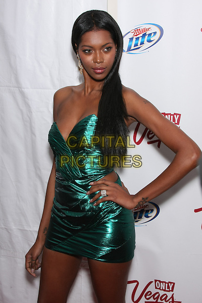 JESSICA WHITE .Attending the 2010 Sports Illustrated Swimsuit Issue Launch Party at Provocateur,  New York, NY, USA, February 9th, 2010..half length strapless green metallic shiny dress hand on hip mini cut out side away .CAP/LNC/TOM.©LNC/Capital Pictures .