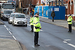 © Joel Goodman - 07973 332324 . 16/01/2014 . Salford , UK . Police block traffic on Chapel Street as the cortege arrives . The funeral of Labour MP Paul Goggins at Salford Cathedral today (Thursday 16th January 2014) . The MP for Wythenshawe and Sale East died aged 60 on 7th January 2014 after collapsing whilst out running on 30th December 2013 . Photo credit : Joel Goodman