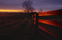 Sunset on fences in the early spring on a Kentucky horse farm.