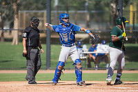 Los Angeles Dodgers catcher Marco Hernandez (96) throws back to the pitcher as Santis Sanchez (44) bats during an Instructional League game against the Oakland Athletics at Camelback Ranch on October 4, 2018 in Glendale, Arizona. (Zachary Lucy/Four Seam Images)