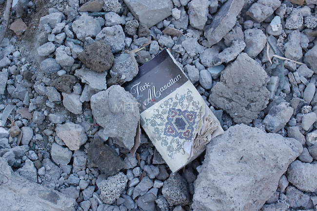 VAN, TURKEY: A book lies in the rubble of a house...On October 23, 2011, a 7.2 magnitude earthquake hit eastern Turkey killing over 250 people and wounding over a thousand...Photo by Ali Arkady/Metrography