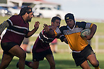 Rangitane Paewae tries to evade the grasp of Manue Fowler and fend off Selwyn Tuhi. CMRFU Counties Power Cup Game of the Week between Te Kauwhata & Puni played at Te Kauwhata on Saturday May the 3rd, 2008..Te Kauwhata led 5 - 0 at halftime & went on to win 29 - 0.