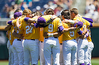 LSU Tigers pregame huddle before the NCAA College baseball World Series against the Cal State Fullerton on June 16, 2015 at TD Ameritrade Park in Omaha, Nebraska. LSU defeated Fullerton 5-3. (Andrew Woolley/Four Seam Images)