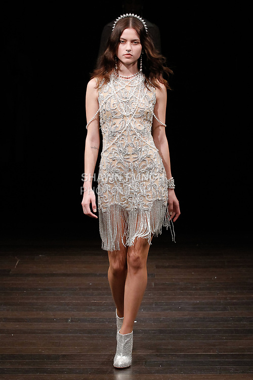 "Model walks runway in an ""Argentina"" after party dress' from the Naeem Khan Bridal Spring 2018 collection, on April 21, 2017; during New York Bridal Fashion Week."