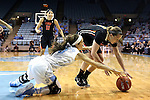 16 December 2014: Oregon State's Ali Gibson (right) and North Carolina's Megan Buckland (3) dive for a loose ball. The University of North Carolina Tar Heels hosted the Oregon State University Beavers at Carmichael Arena in Chapel Hill, North Carolina in a 2014-15 NCAA Division I Women's Basketball game. Oregon State won the game 70-55.