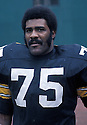 Pittsburgh Steelers Joe Greene (75) during a game from his 1972 season with the Pittsburgh Steelers. Joe Greene  played for 13 years all with the Pittsburgh Steelers, he was a 10-time Pro Bowler and  was inducted to the Pro Football Hall of Fame in 1987.