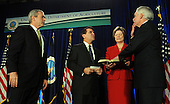 United States President George W. Bush watches as Secretary of Agriculture Ed Schafer takes the oath of office during his Ceremonial Swearing-in at the U.S. Department of Agriculture in Washington on February 6, 2008. Charles F. Conner, deputy secretary of Agriculture, performs the ceremony as Schafer's wife Nancy holds a bible. <br /> Credit: Roger L. Wollenberg / Pool via CNP