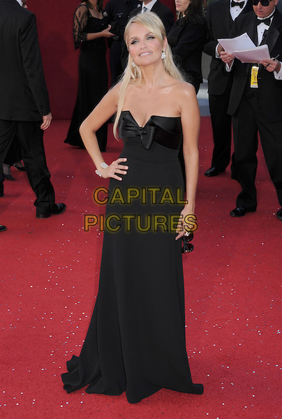 KRISTIN CHENOWETH .60th Annual Primetime Emmy Awards held at the Nokia Theatre, Los Angeles, California, USA,  21 September 2008..emmys red carpet arrivals full length strapless black long maxi dress hand on hip bow.CAP/ADM/BP.©Byron Purvis/Admedia/Capital PIctures