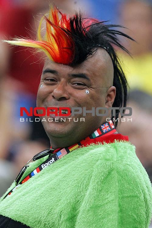 FIFA WM 2006 -  Quarter Finals / Viertelfinale<br /> Play   #59  (30-Jun) - England - Portugal<br /> <br /> Dunkelh&auml;utiger Deutscher Fussball Fan.<br /> Sind wir nicht alle Fans von Deutschland ?<br /> <br /> Foto &copy; nordphoto