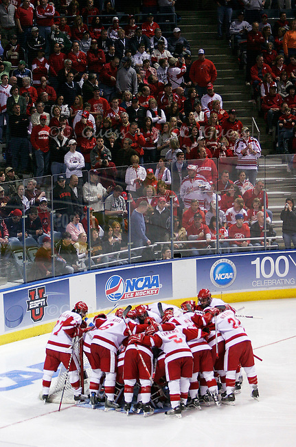 The University of Wisconsin-Madison 2005-2006 men?s hockey team plays Boston College in the final game of the NCAA championship tournament held at the Bradley Center in Milwaukee, Wis. on Apr. 8, 2006.  The Badgers huddle around the goal just before the face off to start the game. Since the game was held only one hour away from the team?s hometown of Madison the stand were essentially a giant sea of red, with hardly any Boston maroon to be seen. Wisconsin would go on to win the game and the championship 2-1.