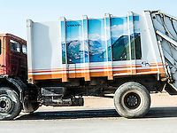 Garbage truck. This truck transfers garbage to save us from its impact on the environment. I likedthe picture on the truck. Mountains and water on a truck inside a desert.