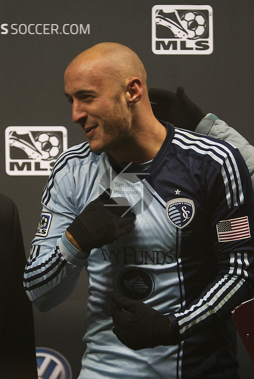 Sporting KC defender Aurelien Collin (78) is honored after the game as the MVP of the MLS Cup.  Sporting KC defeated Real Salt Lake in a shootout after the score was tied 1-1 at the end of regulation play in the MLS Cup 2013 championship held at Sporting Park in Kansas City, Kansas on Saturday December 7, 2013.