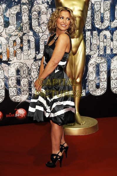 ANASTACIA.At the World Music Awards in Monte Carlo, Monaco, 9th November 2008..arrivals red carpet full length grey gray black and white striped dress striped pearl necklace shoes open toe looking back over shoulder .CAP/TTL .©TTL/Capital Pictures