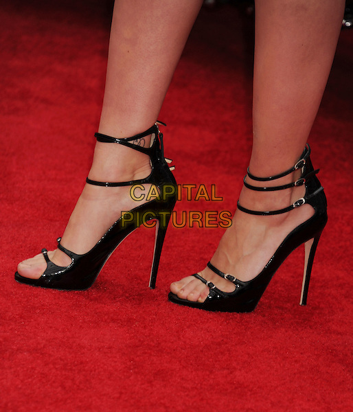 "Scarlett Johansson's shoes.""Marvel's The Avengers"" World Premiere held at the El Capitan Theatre, Hollywood, California, USA..April 11th, 2012.detail black sandals open toe patent ankle straps buckles .CAP/ROT/TM.©Tony Michaels/Roth Stock/Capital Pictures"