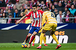 Angel Correa (L) of Atletico de Madrid is tackled by Jonas Ramalho Chimeno of Girona FC during the La Liga 2017-18 match between Atletico de Madrid and Girona FC at Wanda Metropolitano on 20 January 2018 in Madrid, Spain. Photo by Diego Gonzalez / Power Sport Images