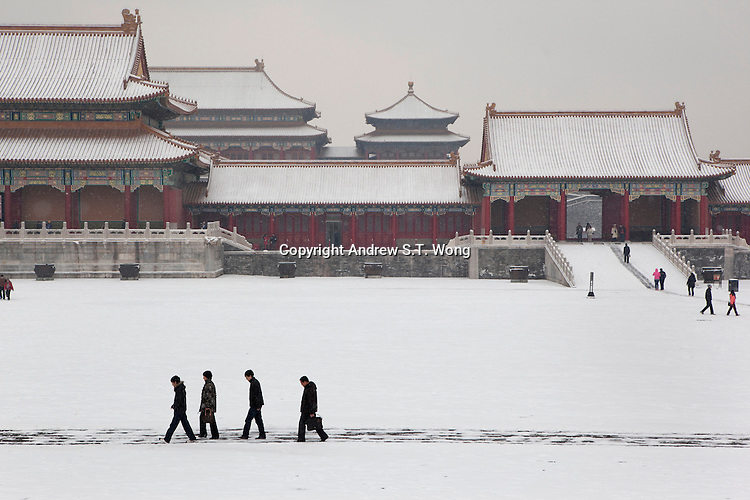 Visitors walk through a snow-covered Forbidden City on February 10, 2011 in Beijing, China. Beijing residents woke up on Thursday morning to the first snow this winter, which arrived as the latest snowfall in 60 years. (Canon 5D Mark II, 24-70mm f2.8)