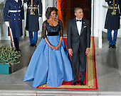 United States President Barack Obama and first lady Michelle Obama await the arrival of President Francois Hollande of France for a State Dinner in his honor on the North Portico of the White House in Washington, D.C. on Tuesday, February 11, 2014.<br /> Credit: Ron Sachs / CNP