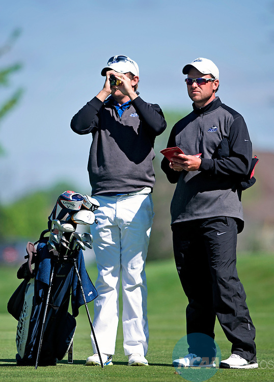 23 MAY 2014:  Mitch Farrer, left, and Ryan Jamison of Nova Southeastern gauge distance to the green during the Division II Men's Golf Championship held at The Meadows in Allendale, MI.    Erik Holladay/NCAA Photos