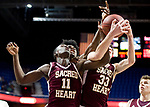 UNCASSVILLE, CT-031818JS17- Sacred Heart's Raheem Solomon and Zachary Francisco (33) battle for a rebound with Notre Dame-Fairfield's Wooley Monnexant (10) during their Division I championship game Sunday at Mohegan Sun Arena. <br /> Jim Shannon Republican-American