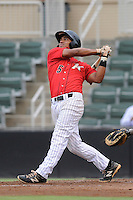 Shortstop Cleuluis Rondon (5) of the Kannapolis Intimidators bats in a game against the Charleston RiverDogs on Saturday, June 28, 2014, at CMC-Northeast Stadium in Kannapolis, North Carolina. Kannapolis won, 4-3. Rondon is the No. 26 prospect of the Chicago White Sox, according to Baseball America.  (Tom Priddy/Four Seam Images)
