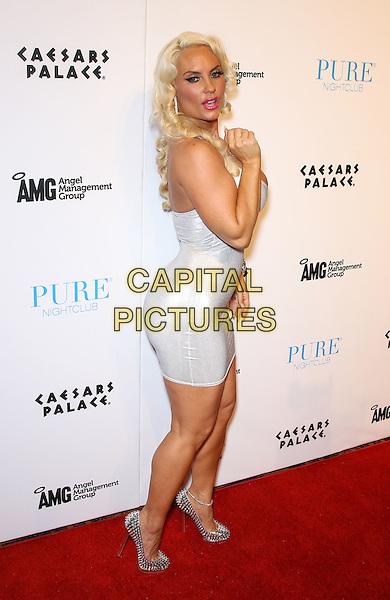 "Nicole ""Coco"" Austin .Ice-T and Coco celebrate second season of reality series ""Ice Loves Coco"" at Pure Nightclub inside Caesar's Palace Resort Hotel and Casino, Las Vegas, Nevada, USA, .11th February 2012..full length silver white dress cleavage side bum ass rear .CAP/ADM/MJT.© MJT/AdMedia/Capital Pictures."