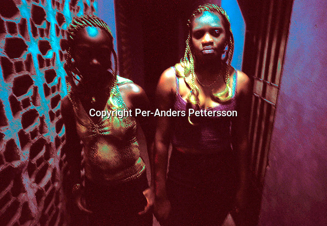 dicocon00192.Congo. Kinshasa. Two young ÒYes girlsÓ, prostitutes in a cheap hotel on February 28, 2002 in central Kinshasa, Congo.  High unemployment and poverty makes it tempting for girls like these to choose this work. The best (wealthy) clients are the foreign aid workers and businessmen living and working in the Congo. .©Per-Anders Pettersson/iAfrika Photos