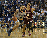 Nevada's Cody Martin (11) drives past Little Rock's Jaizec Lottie (11) in the second half of an NCAA college basketball game in Reno, Nev., Friday, Nov. 16, 2018. (AP Photo/Tom R. Smedes)