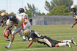 Palos Verdes, CA 09/22/11 - unknown Beverly Hills player(s) and Issac Kuo (Peninsula #28)) in action during the Beverly Hills-Peninsula Varsitty Football gane.